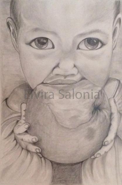 Bambino con mela